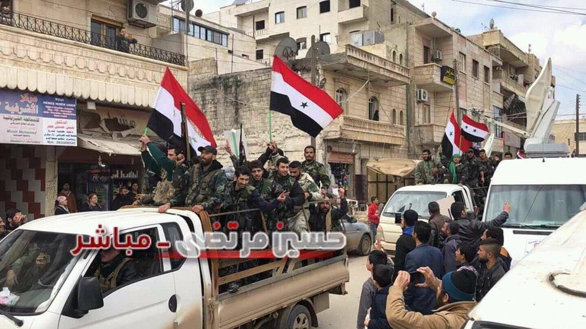 Syrische Regierung und Russland in Afrin und Aleppogefeiert