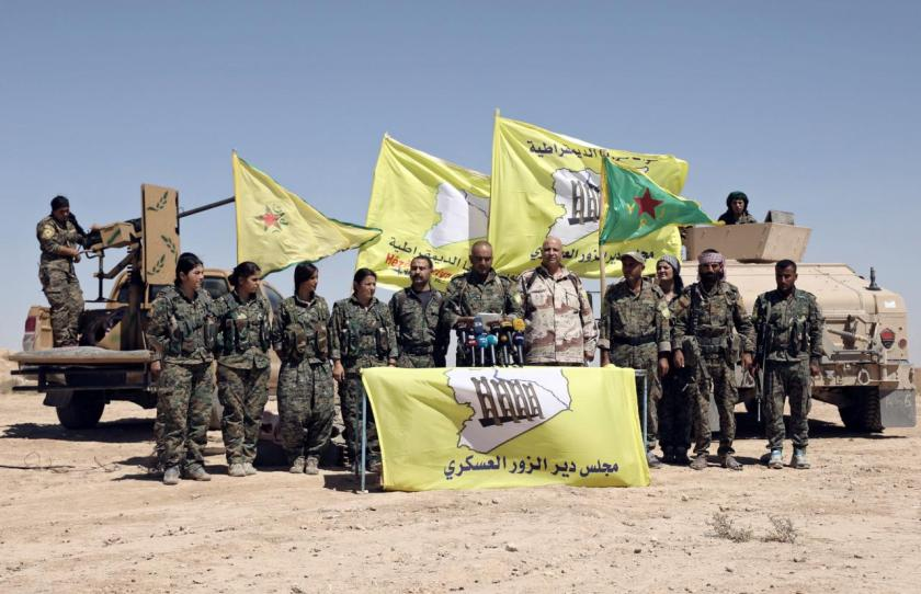Ahmed Abu Kholeh, head of the Deir al-Zor military council which fights under the SDF, speaks during a press conference in the village of Abu Fas